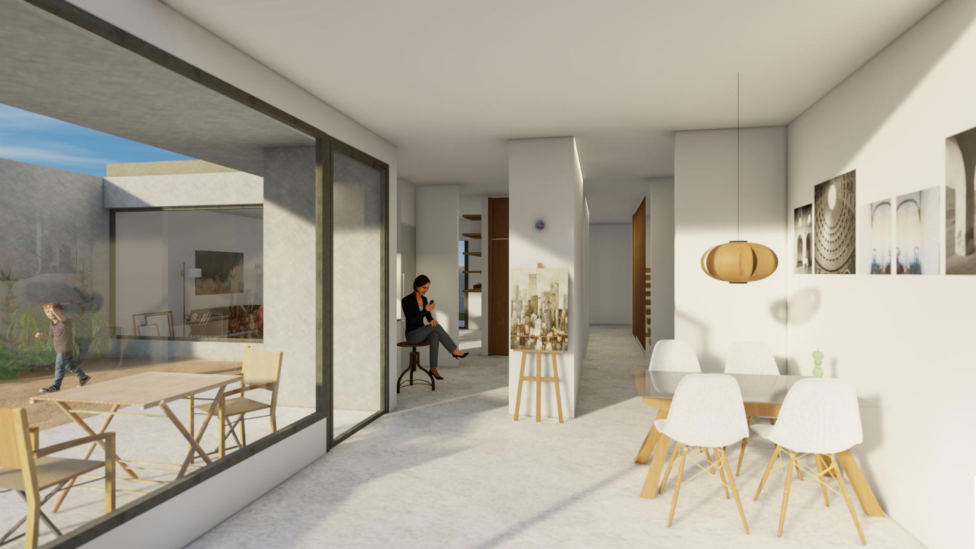 comedor y cocina con vistas a la terraza trasera de la vivienda de nueva construcción unifamiliar al lado del Arboretum, en Lleida